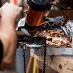 Man fixing chain on machine